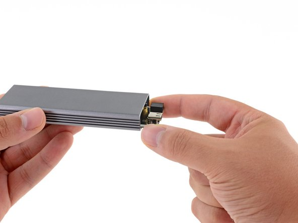 Slide the SSD sled out of the metal enclosure to remove it.