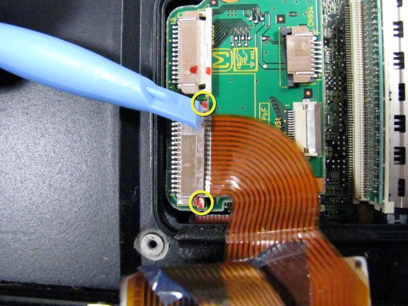 Remove both ribbon cable by pulling 2 white tabs on either side of the cable to the right