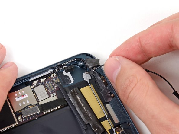 Pull the antenna cable away from its recess in the rear case.