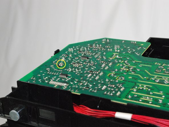 "Using a Phillips #2 screwdriver, remove the 1"" screw attaching the circuit board to the printer."