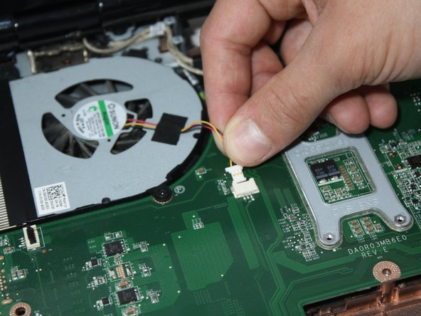 Gently pull the cooling fan cable horizontally to unplug it.