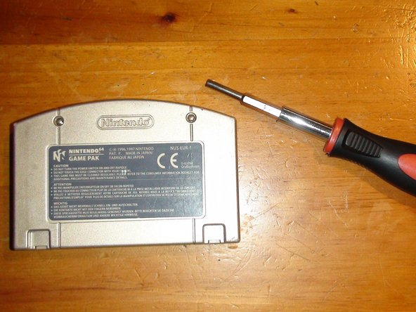 Now on to the main event. Start by connecting your 3.8mm Gamebit to your Modular Screwdriver. Use the Screwdriver to undo the two Gamebit screws that hold the cartridge together. Once undone, carefully remove the back cover of the cartridge to expose the inner metal shielding.
