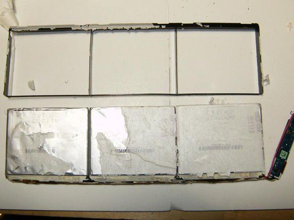 With all the sticky paper separated from the ends of the battery packs, the plastic frame can be removed.