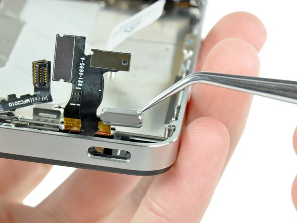 Use a pair of tweezers to remove the power & lock button from the iPhone.
