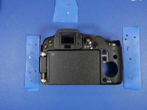 To get further access to the LCD, remove the 2 circled screws.