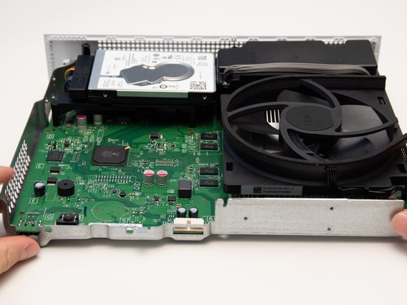 Lift the motherboard up from the metal chassis.