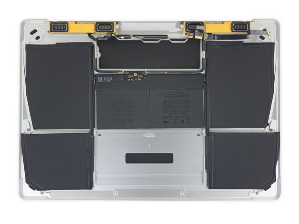 The adhesive securing the battery cells to the lower case is located in the areas marked in red.