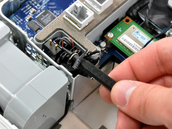 Use the tip of a spudger to lift the speaker cable slightly.
