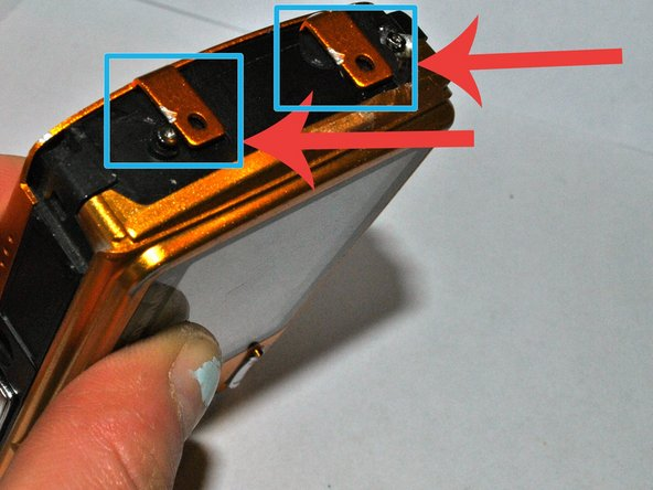 You will need to remove the front panel in order to access the lens. Lift the latches on the side of the front panel to remove it entirely, pulling gently in an upward motion.