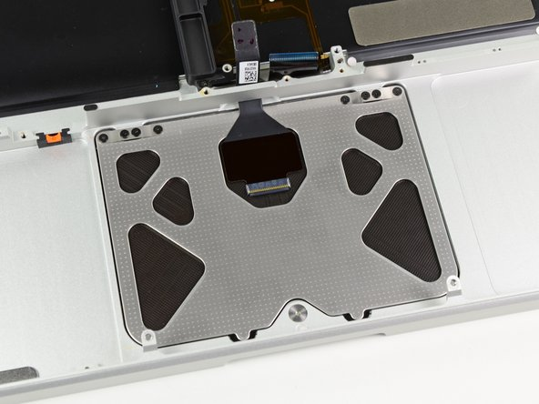 Tighten the outer two screws along the inner edge of the trackpad and check the alignment of it on the outer side of the upper case.