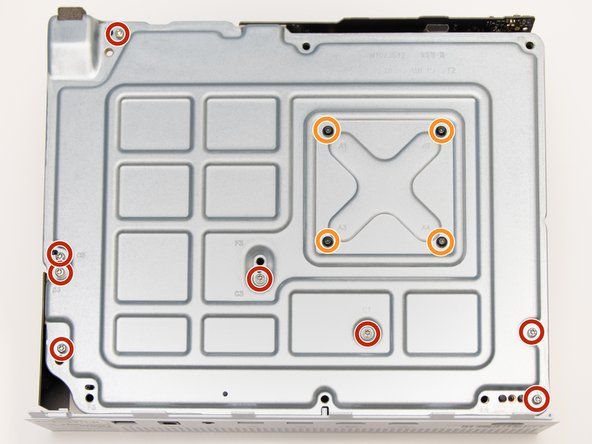 Remove the eight 10mm screws from the bottom of the metal casing using the Torx T9 screwdriver.