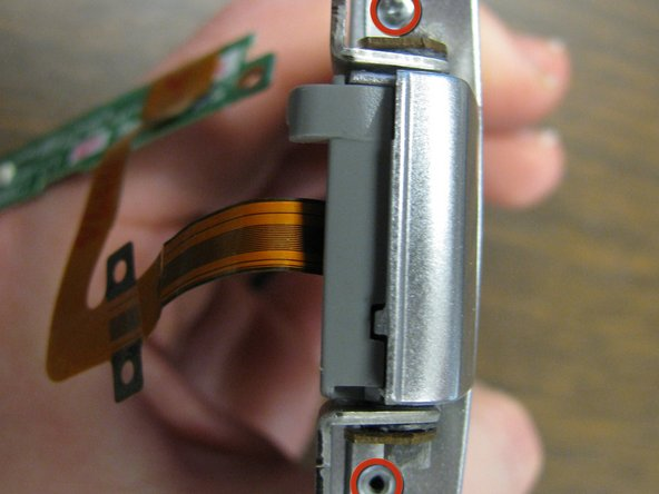 Remove 2 screws on hinge side of LCD screen.