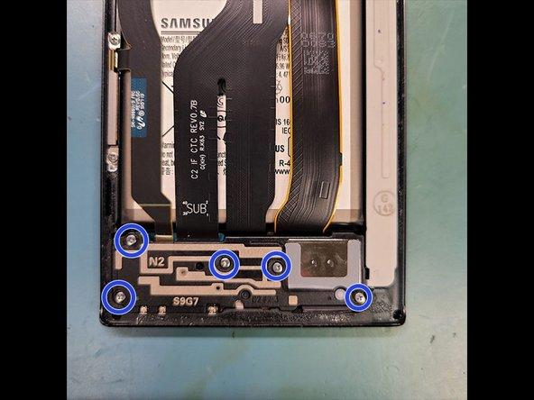 Remove 5 PH000 Screws for the Loudspeaker bracket