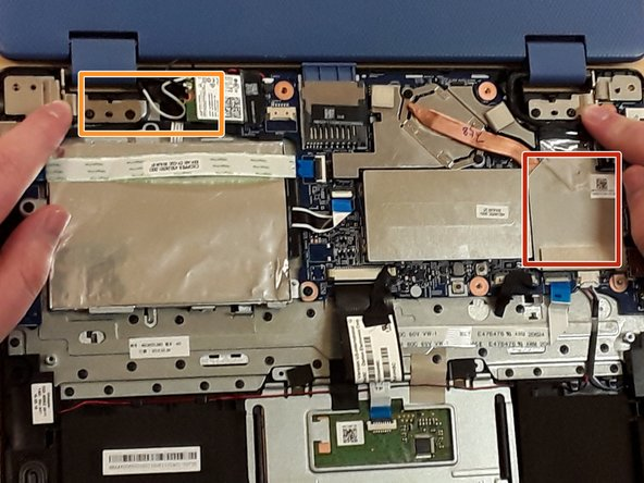 On the right side, locate the piece of clear tape connected to the cooling system (also called a heat sink).