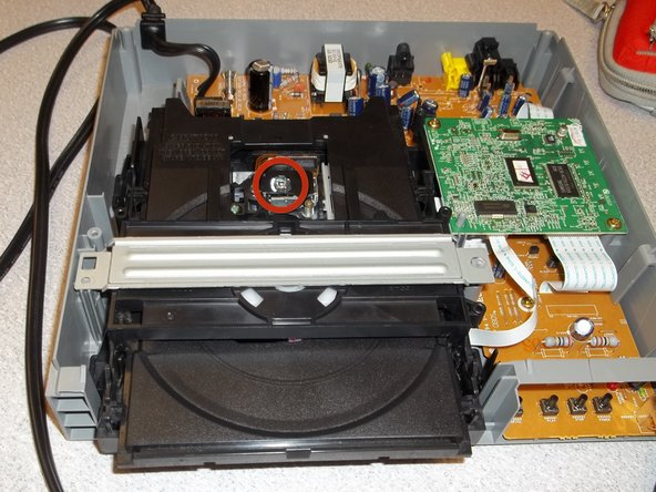 How to clean the Magnavox MWD200F optical lens