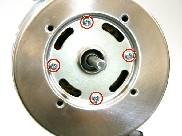 Remove the four 6 mm bolts and small washers that secure the front face of the motor housing with a Phillips #3 screwdriver and remove the washers.