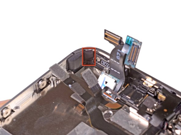 Remove the small pieces of black tape covering the display mounting tabs.
