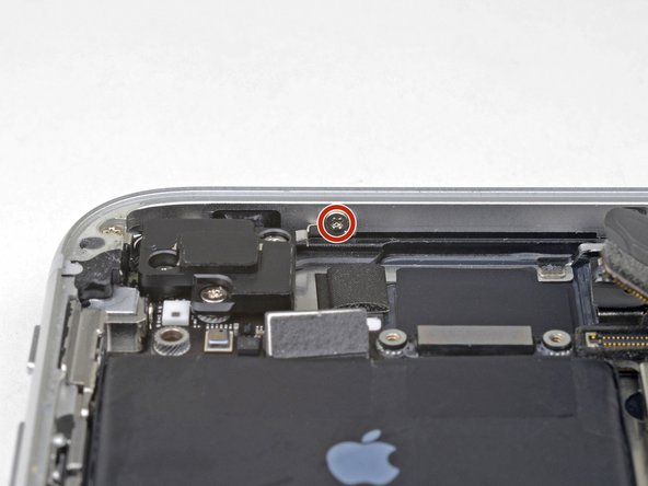 Remove the 1.4 mm Phillips screw securing the antenna component to the top of edge of the case.