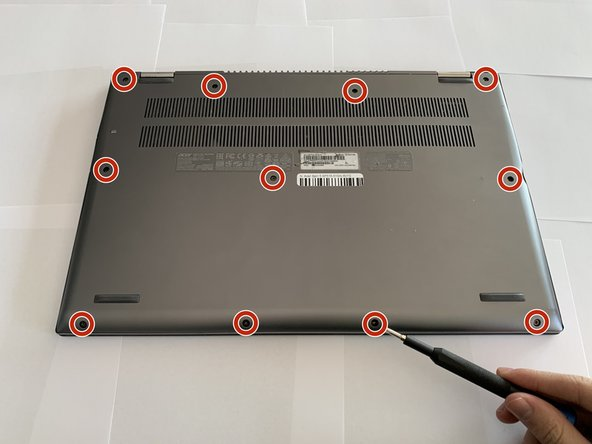 Remove the eleven 6.5 mm screws that secure the back case using a Phillips #1 screwdriver.