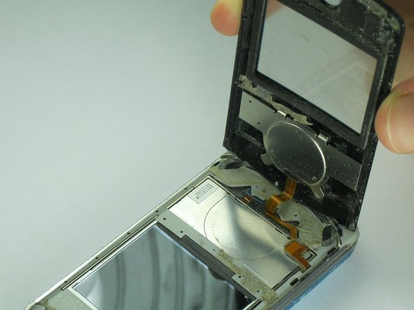 The scroll wheel has an orange display data cable attached which may rip from excessive force.