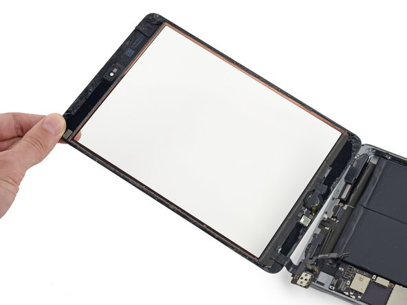 Lift and remove the front panel assembly from the iPad.