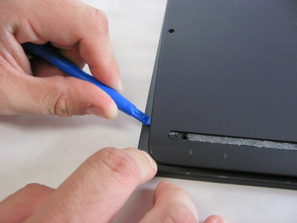 Use the Plastic Opening Tools or Metal Spudger to carefully loosen back cover from the body of the computer.