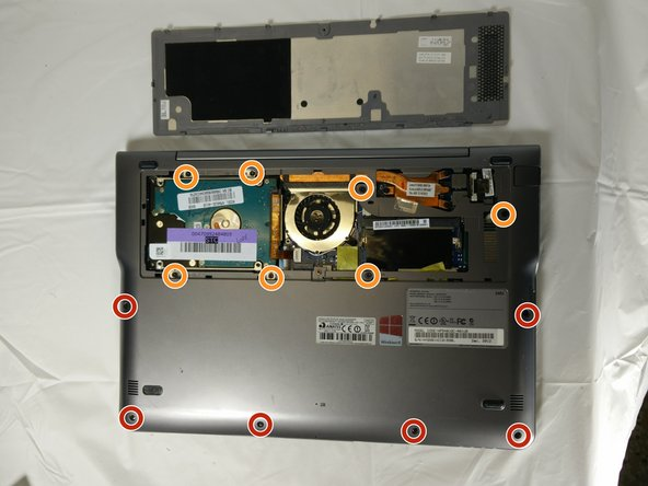Power off the device. Remove the remaining screws holding the back cover in place: