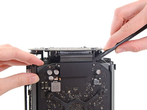 Use the flat end of a spudger and a twisting motion to gently separate one side of the graphics card data connection.