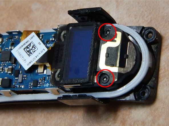 Once removed, there are 2 torx screws holding the circuit board in place.  Remove these, and carefully pry the board out