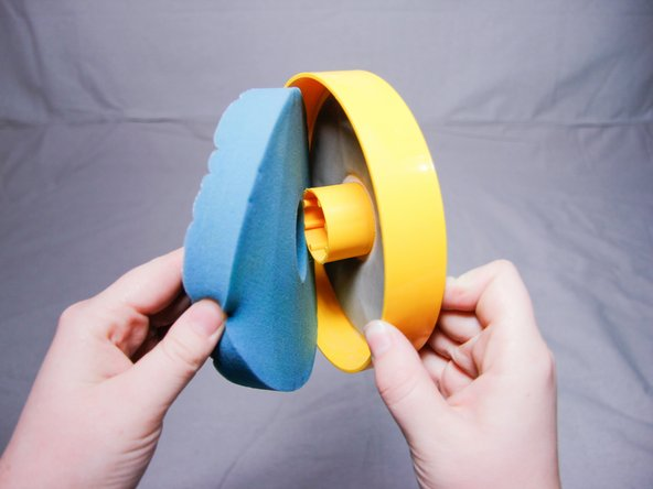Remove the blue sponge-filter from the yellow filter housing.