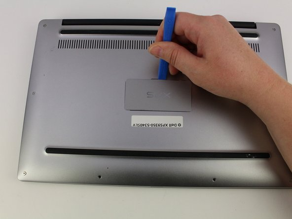 Use a plastic opening tool to pry open the 'XPS' flap in the middle.