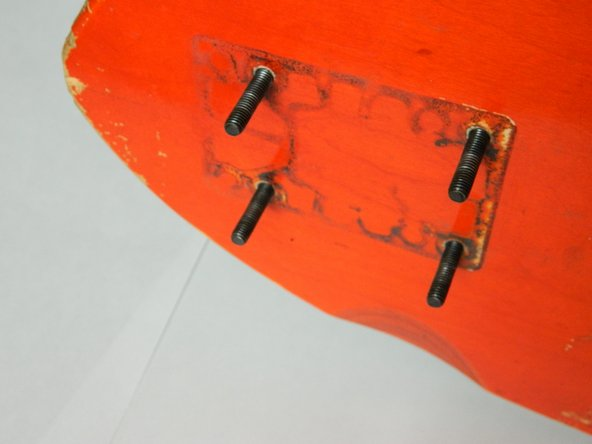Insert bolt hardware through the factory drilled holes from the top side of the skateboard.