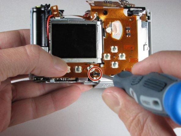 Remplacement du flexible des boutons de la caméra Canon Powershot A70