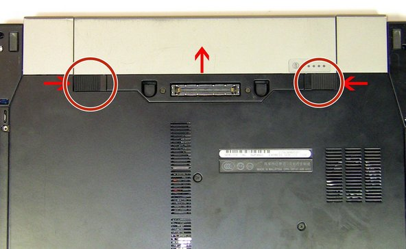 Release the latch or latches connected to the battery  that hold it in place.