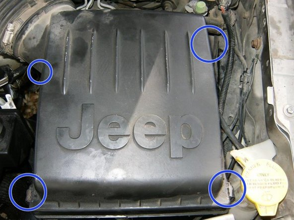 To remove the hoses from the power steering pump, the air cleaner housing has to be removed. Remove the four clips on the air filter cover