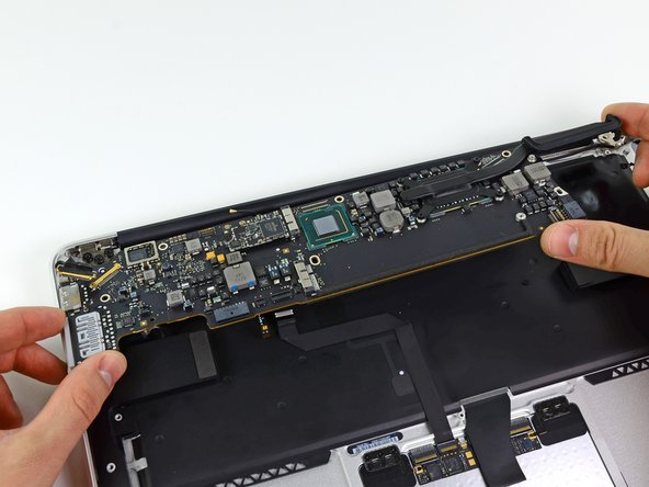 Carefully remove the logic board assembly from the upper case, minding any cables that may get caught.