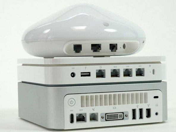 From bottom up: Mac Mini, new base station, old base station.