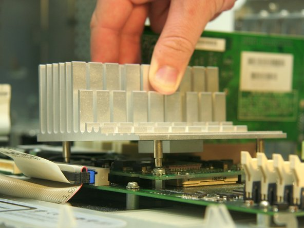 Remove the heat sink by pulling upwards, off of the logic board.