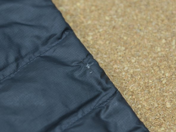 Locate the hole in your down jacket. In order to prevent all the feathers from escaping through the hole, you'll have to replace the entire baffle.