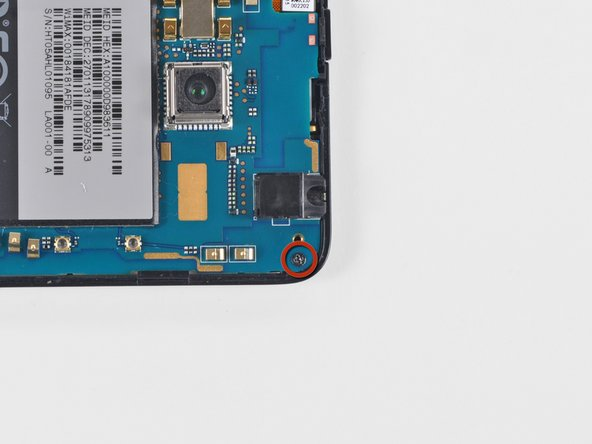 Remove the single Phillips screw securing the motherboard to the inner case near the headphone jack.