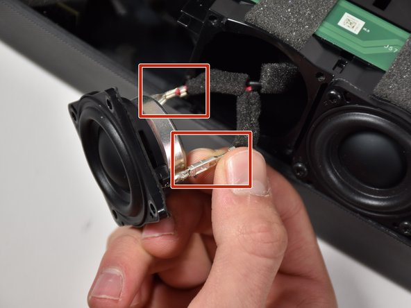 Remove the red and black clips by pinching and pulling on each tab.