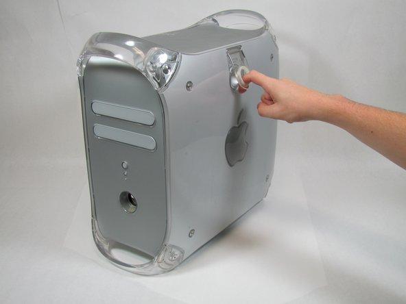 Grab the circular handle and pull outward.