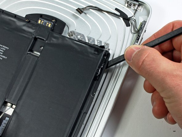 The battery is held to the rear panel by an excessive amount of adhesive. Proceed with patience and caution.