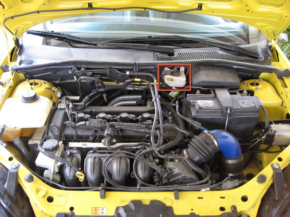 The brake fluid reservoir is located towards the back of the engine compartment.