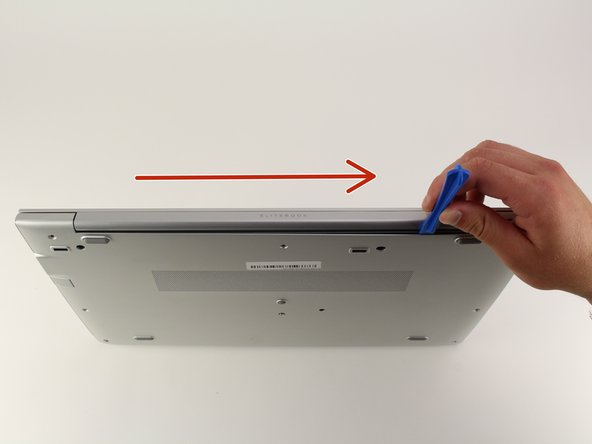 Turn computer so that the hinged side is facing up.