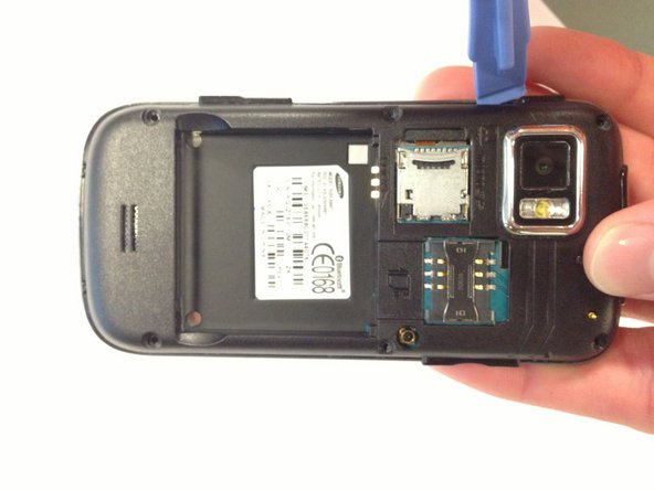 Insert a plastic opening tool into the seam between the back case and the rest of the phone.