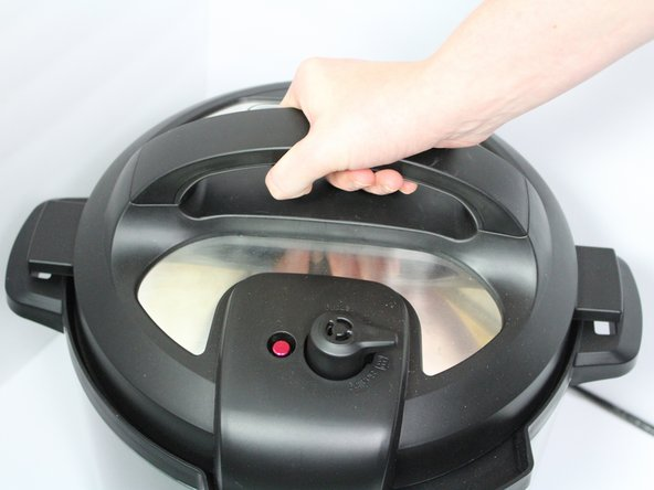 Open the lid by turning it counter-clockwise and lifting up.