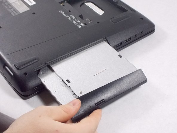 Remove the 3 small screws located underneath the disk drive.