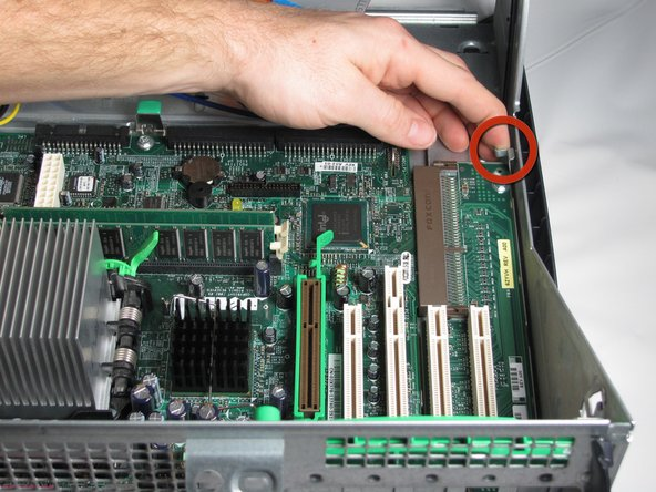 Lift the metal tab near the right corner of the motherboard.