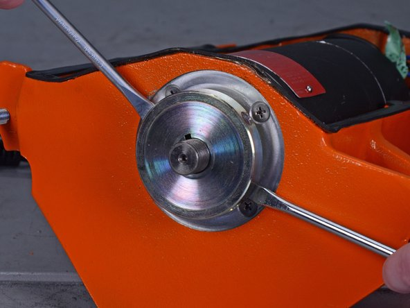 Use two flathead screwdrivers to carefully pry the inner flange off the motor shaft.